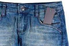 Escritura de la etiqueta de los pantalones vaqueros del papel de la etiqueta del espacio en blanco del detalle de los tejanos Imagen de archivo libre de regalías