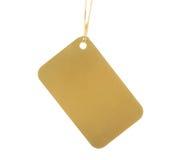 Escritura de la etiqueta de oro en cinta Imágenes de archivo libres de regalías