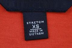 Escritura de la etiqueta de vestir Foto de archivo libre de regalías