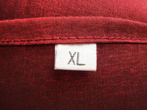 Escritura de la etiqueta de vestir Fotos de archivo libres de regalías