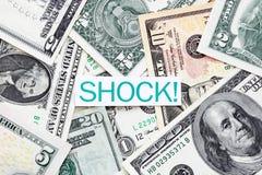 Escritura de la etiqueta del choque en cuentas de dólar americano fotografía de archivo libre de regalías