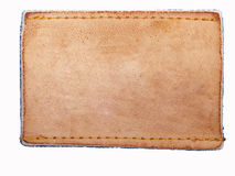 Escritura de la etiqueta en blanco del cuero de los pantalones vaqueros en tela de la mezclilla Imágenes de archivo libres de regalías