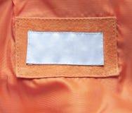 Escritura de la etiqueta en la ropa Foto de archivo libre de regalías