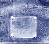 Escritura de la etiqueta en pantalones vaqueros Imágenes de archivo libres de regalías