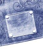 Escritura de la etiqueta en pantalones vaqueros Imagen de archivo