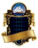 escritura de la etiqueta Oro-enmarcada con una nave Imagen de archivo