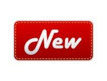 Escritura de la etiqueta roja con el nuevo texto. Foto de archivo libre de regalías