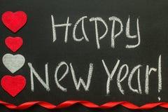Escritura de la Feliz Año Nuevo en una pizarra Imagen de archivo
