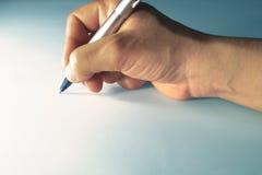 Escritura de la mano imágenes de archivo libres de regalías