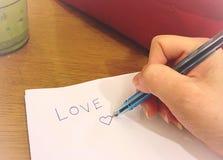 Escritura de la mano Fotografía de archivo