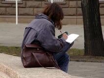 Escritura de la muchacha Foto de archivo