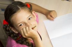 Escritura de la muchacha Imagen de archivo libre de regalías