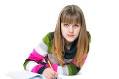 Escritura de la muchacha adolescente Foto de archivo