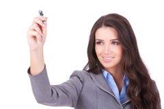 Escritura de la mujer de negocios Imagen de archivo libre de regalías