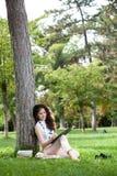 Escritura de la mujer joven Foto de archivo libre de regalías