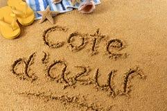Escritura de la playa de Cote d'Azur Foto de archivo libre de regalías