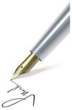 Escritura de la pluma en el papel Imágenes de archivo libres de regalías