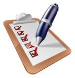 Escritura de la pluma en el tablero Imagen de archivo libre de regalías