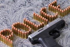 Escritura de la policía con las balas Fotos de archivo libres de regalías