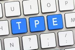 Escritura de la TPE en el teclado blanco Fotografía de archivo libre de regalías