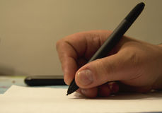 Escritura de las manos Fotografía de archivo libre de regalías