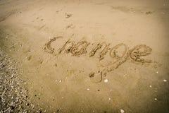 Escritura de palabras del cambio en la arena Fotografía de archivo libre de regalías