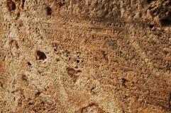 Escritura de piedra del griego clásico Imagenes de archivo