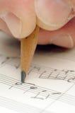 Escritura de una canción Fotos de archivo libres de regalías
