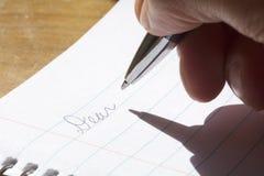 Escritura de una letra Fotografía de archivo