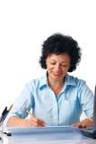Escritura de una más vieja mujer. fotos de archivo