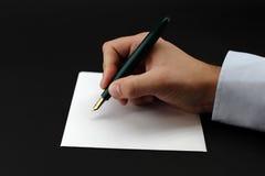 Escritura de una nota Imágenes de archivo libres de regalías
