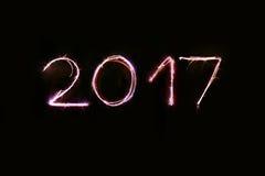 Escritura del Año Nuevo con las bengalas Imagen de archivo libre de regalías