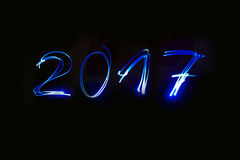Escritura del Año Nuevo con pirotecnia Imagen de archivo libre de regalías