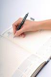 Escritura del asunto en una reunión Imagen de archivo libre de regalías