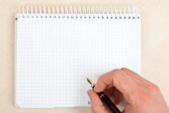 Escritura del cuaderno Imagenes de archivo