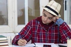 Escritura del estudiante Foto de archivo