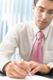 Escritura del hombre de negocios Imagen de archivo