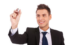 Escritura del hombre de negocios con la etiqueta de plástico Imagen de archivo libre de regalías
