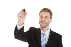 Escritura del hombre de negocios en la pantalla invisible con el marcador Foto de archivo
