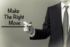 Escritura del hombre de negocios - haga el movimiento correcto Imagenes de archivo
