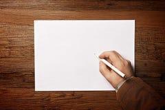 Escritura del hombre en el papel Imágenes de archivo libres de regalías