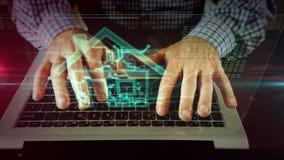 Escritura del hombre en el teclado del ordenador port?til con el s?mbolo casero del iot