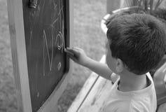 Escritura del niño imagenes de archivo