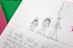 Escritura del niño fotografía de archivo libre de regalías