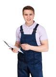 Escritura del trabajador en una tablilla Foto de archivo libre de regalías