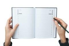 Escritura en el cuaderno fotos de archivo