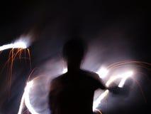 Escritura en la noche con el fuego Fotografía de archivo