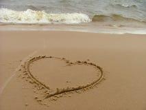 Escritura en la playa Fotos de archivo libres de regalías