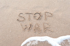 Escritura en la playa arenosa Fotografía de archivo