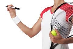 Escritura femenina del jugador de tenis algo Fotografía de archivo